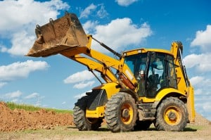 Wheel loader Excavator with backhoe unloading sand at eathmoving