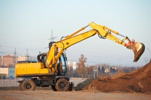 wheel loader excavator machine doing earthmoving work at sand qu